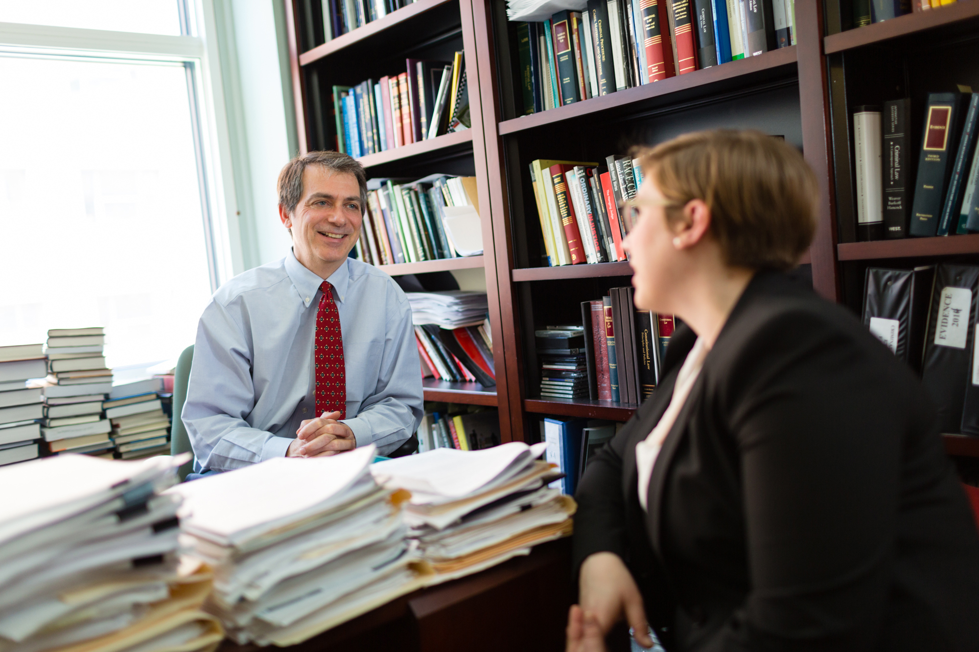 Professor explains JD law degree curriculum to a law student.