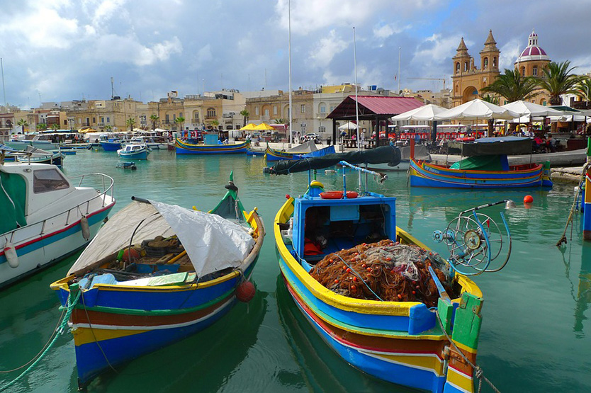 Fishing boats in Malta; study international law with one of New England Law | Boston's many study abroad programs.